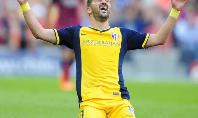FILE - In this May 17, 2014 file photo, Atletico's David Villa celebrates at the end of a Spanish La Liga soccer match between FC Barcelona and Atletico Madrid at the Camp Nou stadium in Barcelona, Spain. Villa has signed a three-year contract with New York City FC, becoming the first player on the expansion Major League Soccer team that starts play next season. (AP Photo/Manu Fernandez, File)