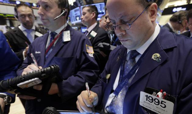 FILE - In this Thursday, Jan. 10, 2013, file photo, Jeffrey Vazquez, right, works with fellow traders on the floor of the New York Stock Exchange. Stock futures jumped Thursday, Jan. 17, 2013,  as the government reported that weekly applications for unemployment benefits hit a five-year low and the construction of new homes surged. (AP Photo/Richard Drew)