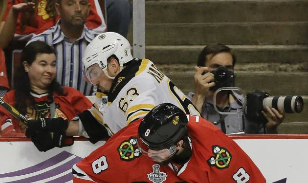 Chicago Blackhawks defenseman Nick Leddy (8) gets tangled up with Boston Bruins left wing Brad Marchand (63) in the second period during Game 2 of the NHL hockey Stanley Cup Finals, Saturday, June 15, 2013, in Chicago. (AP Photo/Nam Y. Huh)
