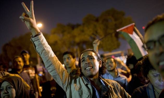 Egyptians chant slogans against latest Israel airstrikes in Gaza during a protest in Cairo, Wednesday, Nov. 14, 2012. Egypt has recalled its ambassador to Israel after an Israeli airstrike killed the military commander of Gaza's ruling Hamas. In a statement read on state TV, a spokesman says that President Mohammed Morsi recalled the ambassador and has asked the Arab League's secretary general to convene an emergency ministerial meeting in the wake of the Gaza violence. (AP Photo/Bernat Armangue)