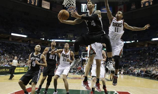 San Antonio Spurs' Danny Green (4) shoots against Milwaukee Bucks' Monta Ellis (11) during the second half of an NBA basketball game on Wednesday, Jan. 2, 2013, in Milwaukee. (AP Photo/Morry Gash)