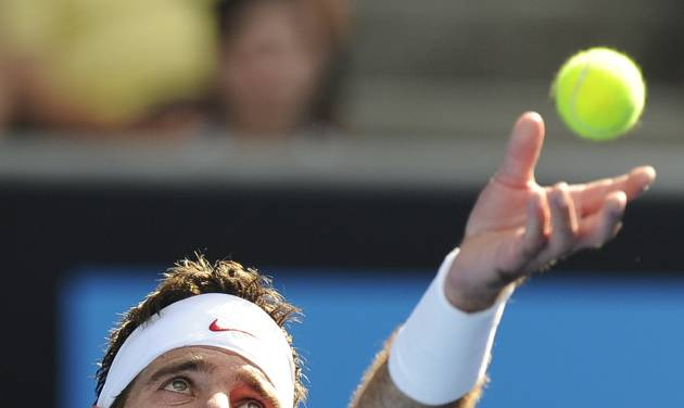 Juan Martin del Potro of Argentina serves to Rhyne Williams of the U.S. during their first round match at the Australian Open tennis championship in Melbourne, Australia, Tuesday, Jan. 14, 2014. (AP Photo/Andrew Brownbill)
