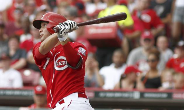 Cincinnati Reds' Kristopher Negron bats in the fourth inning of a baseball game against the Pittsburgh Pirates, Sunday, July 13, 2014, in Cincinnati. Negron grounded out on the at-bat.  (AP Photo/David Kohl)