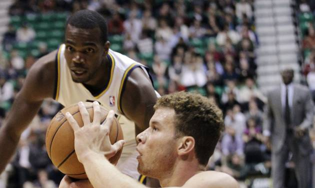 Los Angeles Clippers power forward Blake Griffin (32) shoots from the floor as Utah Jazz power forward Paul Millsap rushes to him in the first quarter of an NBA basketball game, Monday, Dec. 3, 2012, in Salt Lake City. (AP Photo/Rick Bowmer)