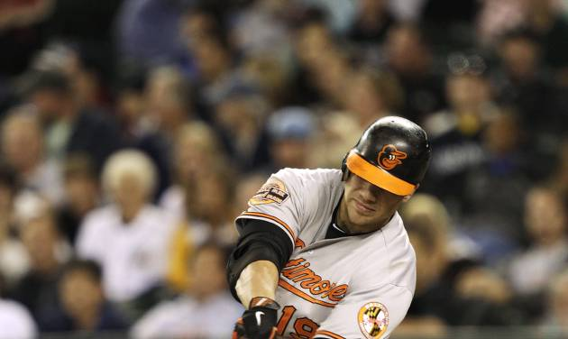 Baltimore Orioles' Chris Davis hits a two-run single against the Seattle Mariners to tie the game in the ninth inning of a baseball game, Tuesday, Sept. 18, 2012, in Seattle. (AP Photo/Ted S. Warren)