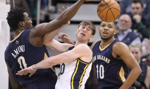 New Orleans Pelicans' Al-Farouq Aminu (0) steals the ball from Utah Jazz's Gordon Hayward, center, as Pelicans' Eric Gordon (10) watches during the first quarter of an NBA basketball game Wednesday, Nov. 13, 2013, in Salt Lake City. (AP Photo/Rick Bowmer)