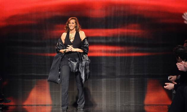 FILE - In this Feb. 10, 2014 file photo, Designer Donna Karan greets the audience after the Donna Karan New York Fall 2014 collection was presented during Fashion Week, at 23 Wall Street in New York. An organization that works on global development through fashion plans to honor Karan for her work with artisans in Haiti and around the world. Fashion 4 Development, a partner of the United Nations' millennium development initiative, will award the New York-based designer its medal of honor at a luncheon Sept. 23, 2014, at The Pierre hotel.   (AP Photo/Diane Bondareff, file)