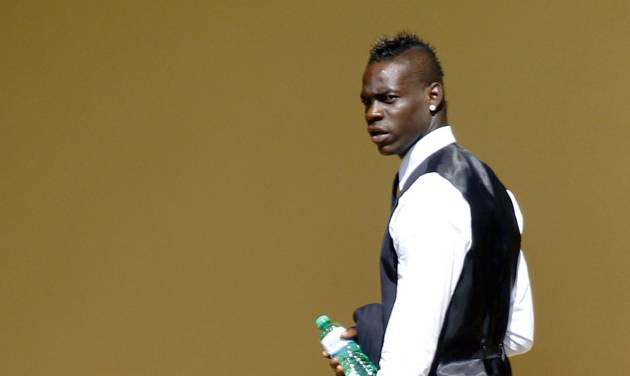 Italy forward Mario Balotelli, wears the official team suit at the Coverciano center, near Florence, Italy, Tuesday, June 3, 2014. (AP Photo/Fabrizio Giovannozzi)