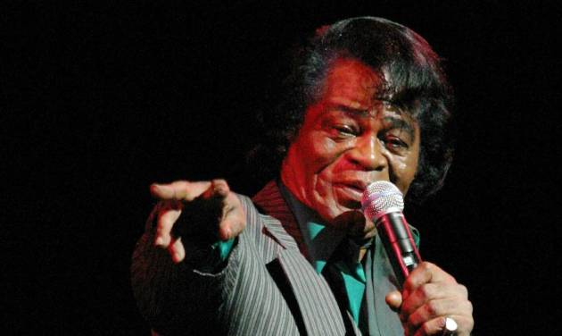 "FILE - In this file photo of Oct. 3, 2004, James Brown performs at Rev. Al Sharpton's 50th birthday celebration at the Apollo theater in the Harlem neighborhood of New York. The legendary theater will host in October, 2013 a world premiere of a dance performance set to the music of the ""Godfather of Soul"" James Brown. The theater is partnering with the city of Lafayette, La., on ""James Brown: Get on the Good Foot, A Celebration in Dance."" (AP Photo/Tina Fineberg, File)"