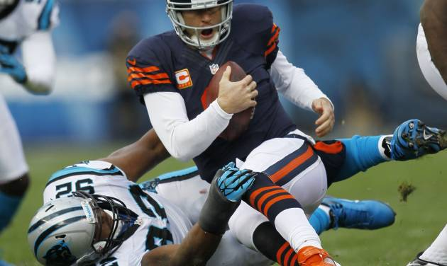 Chicago Bears quarterback Jay Cutler (6) is tackled by Carolina Panthers defensive tackle Dwan Edwards (92) during the first half of an NFL football game in Chicago, Sunday, Oct. 28, 2012. (AP Photo/Charles Rex Arbogast)