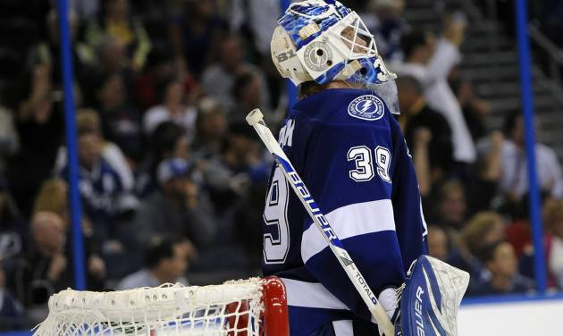 Tampa Bay Lightning goalie Anders Lindback, of Sweden, reacts after allowing a goal by Montreal Canadiens center David Desharnais during the shootout of an NHL hockey game Tuesday, Feb. 12, 2013, in Tampa, Fla. (AP Photo/Brian Blanco)