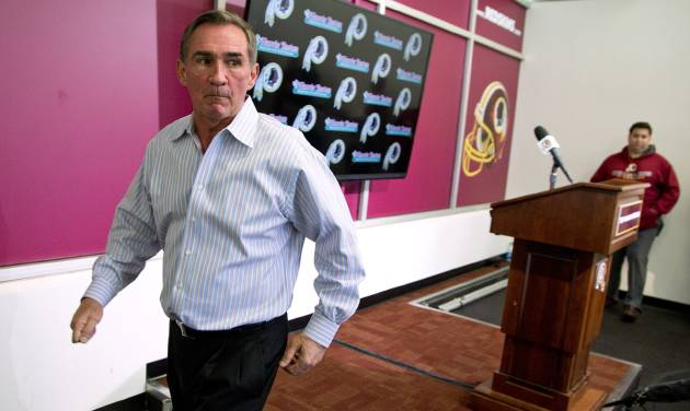 Former Washington Redskins head coach Mike Shanahan walks off after making a statement he was fired on Monday, Dec. 30, 2013 at Redskins Park, in Ashburn, Va. Shanahan was fired after a morning meeting with owner Dan Snyder and general manager Bruce Allen. (AP Photo/ Evan Vucci)