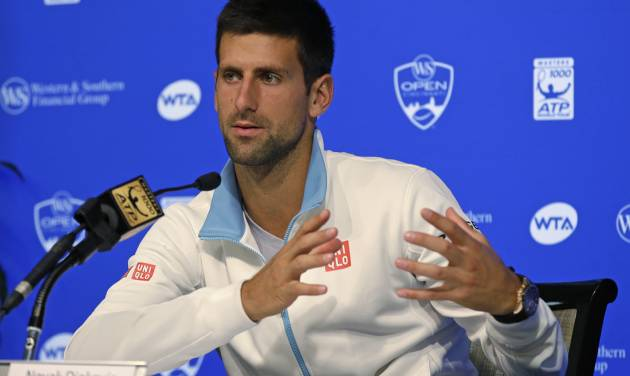 Novak Djokovic, from Serbia, answers questions during a news conference at the Western & Southern Open tennis tournament, Sunday, Aug. 10, 2014, in Mason, Ohio. Djokovic, the top seed, has been a finalist four times at the event, but has never won. (AP Photo/Al Behrman)