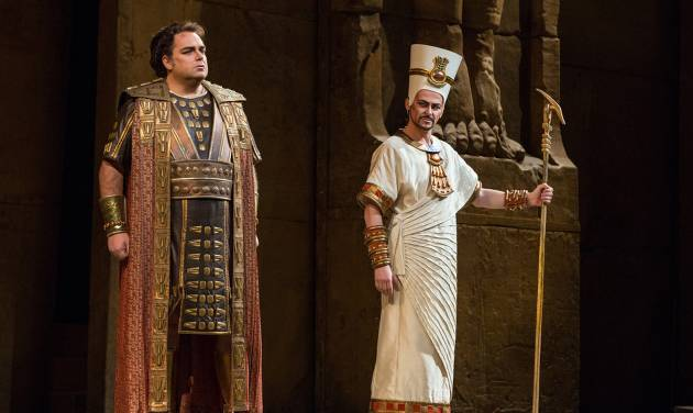 "In this Nov. 15, 2012 photo provided by the Metropolitan Opera, Marco Berti, left, performs as Radames and Stefan Kocan as Ramfis in Verdi's ""Aida,"" during a dress rehearsal at the Metropolitan Opera in New York. (AP Photo/Metropolitan Opera, Marty Sohl)"