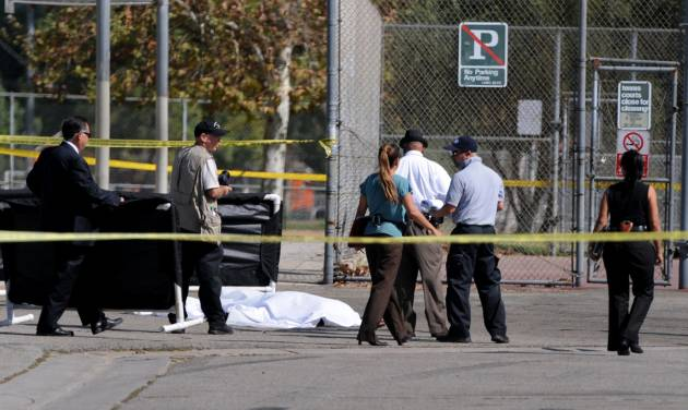 """Los Angeles Police Department officers investigate the scene of a shooting Sunday, Aug. 24, 2014, where one person was killed near the 14400 block of Polk Street in Sylmar, Calif.  Describing what they called """"a major public threat,"""" Los Angeles police said they are seeking clues to three separate shootings in the Northeast San Fernando Valley that left three people dead and four others injured early Sunday morning and appear to be connected. A suspect in the shootings was taken into custody by SWAT officers Sunday night after holing up inside a house in the Sylmar neighborhood for about an hour, Capt. William Hayes said.  (AP Photo/Los Angeles Daily News, Dean Musgrove)"""