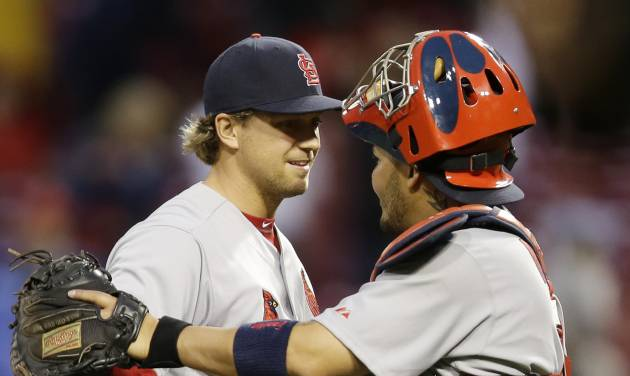 St. Louis Cardinals relief pitcher Trevor Rosenthal, left, is congratulated by catcher Yadier Molina after they defeated the Cincinnati Reds 7-6 in a baseball game on Thursday, April 3, 2014, in Cincinnati. Rosenthal recorded his second save of the season. (AP Photo/Al Behrman)