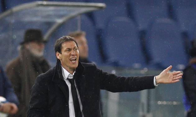 AS Roma coach Rudi Garcia calls out to his players during a Serie A soccer match between AS Roma and Torino, at Rome's Olympic Stadium, Tuesday, March 25, 2014. (AP Photo/Andrew Medichini)