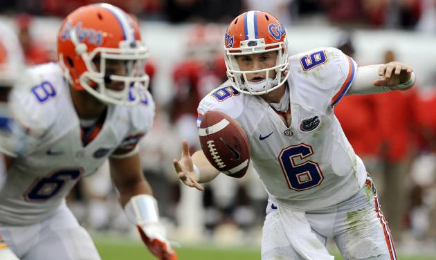Florida quarterback Jeff Driskel (6) bobbles the ball during the first half of an NCAA college football game against Georgia, Saturday, Oct. 27, 2012 in Jacksonville, Fla. (AP Photo/Stephen Morton)