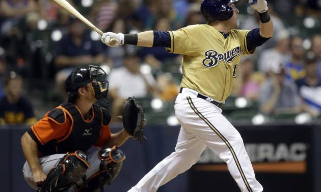 Milwaukee Brewers' Caleb Gindl, right, hits a walkoff home run during the 13th inning of a baseball game against the Miami Marlins, Sunday, July 21, 2013, in Milwaukee. (AP Photo/Morry Gash)