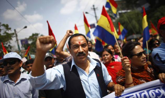 Supporters of pro-monarchy Rastriya Prajatantra Party take out a rally demanding that Nepal be declared a Hindu nation in Katmandu, Nepal, Monday, May 28, 2012. Nepal sank into political turmoil Monday after lawmakers failed to agree on a new constitution, leaving the country with no legal government. (AP Photo/Niranjan Shrestha)