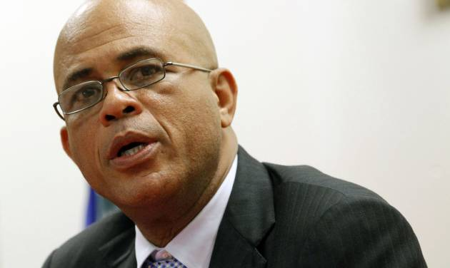 President Michel Martelly talks to reporters during a news conference, Monday, Dec, 10, 2012, in North Miami Beach, Fla. Martelly met with members of the Haitian-American community during his visit to South Florida. Haiti's government has been pitching business and tourism opportunities in the Caribbean country to Haitians living abroad, along with international investors. (AP Photo/Alan Diaz)