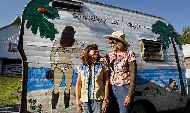 Members of Sisters on the Fly, Terry Dykstra of Topeka, Kan., left, and Pam Willcott of Linwood, Kan., seen at a gathering in Louisburg, Kansas on April 21, 2012, are proud of the artwork on their camper. Sisters on the Fly is a national group of camping enthusiasts founded by two actual sisters who love fly-fishing in Montana. (Jill Toyoshiba/Kansas City Star/MCT)
