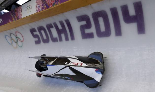 The USA-1, men's two man bobsled team from the United States, take a turn during a training run at the 2014 Winter Olympics, Wednesday, Feb. 5, 2014, in Krasnaya Polyana, Russia. (AP Photo/Michael Sohn)