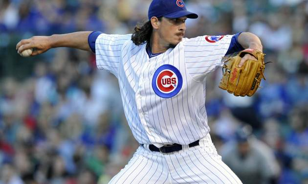 Chicago Cubs' Jeff Samardzija pitches against the Milwaukee Brewers during the first inning of a baseball game, Monday, July 29, 2013, in Chicago. (AP Photo/Jim Prisching)
