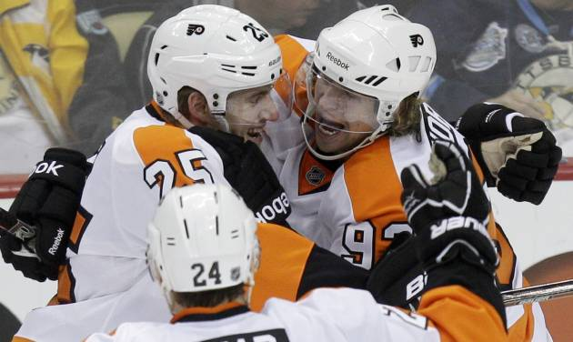 Philadelphia Flyers' Jakub Voracek (93) celebrates his game-winning goal in overtime with teammates Matt Carle (25) and Matt Read (24) during Game 1 of the opening-round NHL hockey playoff series against the Pittsburgh Penguins on Wednesday, April 11, 2012 in Pittsburgh. The Flyers won 4-3. (AP Photo/Gene J. Puskar)