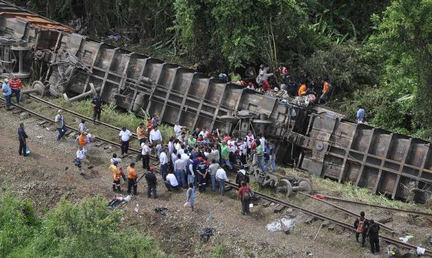 "In this image released by the Tabasco state government press office on Sunday Aug. 25, 2013, rescue workers try to evacuate the injured after a cargo train, known as ""the Beast"", derailed near the town of Huimanguillo, southern Mexico. The cargo train, carrying at least 250 Central American hitchhiking migrants derailed in a remote region, killing at least five people and injuring dozens, authorities said. (AP Photo/Tabasco state government press office)"