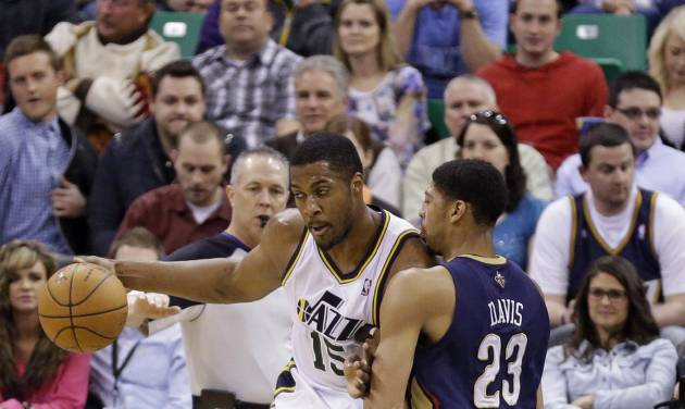 New Orleans Pelicans' Anthony Davis (23) defends against Utah Jazz's Derrick Favors (15) in the first quarter during an NBA basketball game on Friday, April 4, 2014, in Salt Lake City. (AP Photo/Rick Bowmer)