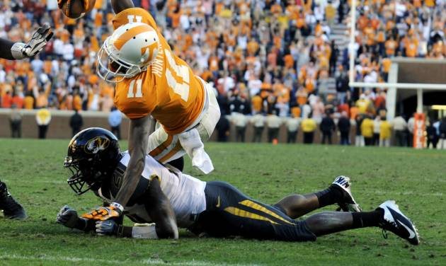 Tennessee wide receiver Justin Hunter (11) pushes past Missouri safety Ian Simon (21) to score a touchdown in the third overtime of an NCAA college football game at Neyland Stadium Saturday, Nov. 10, 2012, in Knoxville, Tenn. Missouri defeated Tennessee 51-48 in four overtimes. (AP Photo/Knoxville News Sentinel, Amy Smotherman Burgess)