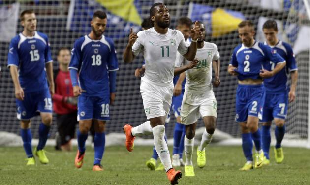 Ivory Coast's Didier Drogba (11) celebrates after scoring on a penalty kick during the second half in an international friendly soccer match against Bosnia-Herzegovina on Friday, May 30, 2014, in St. Louis. Bosnia-Herzegovina won 2-1. (AP Photo/Jeff Roberson)