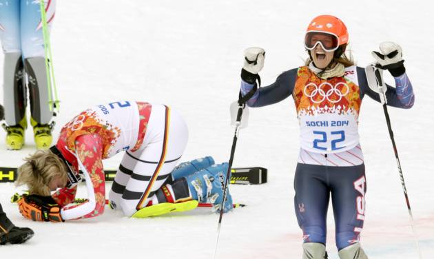 Germany's Maria Hoefl-Riesch, left, and United States' Julia Mancuso react after winning the gold and bronze medal in the women's supercombined at the Sochi 2014 Winter Olympics, Monday, Feb. 10, 2014, in Krasnaya Polyana, Russia. (AP Photo/Charles Krupa)