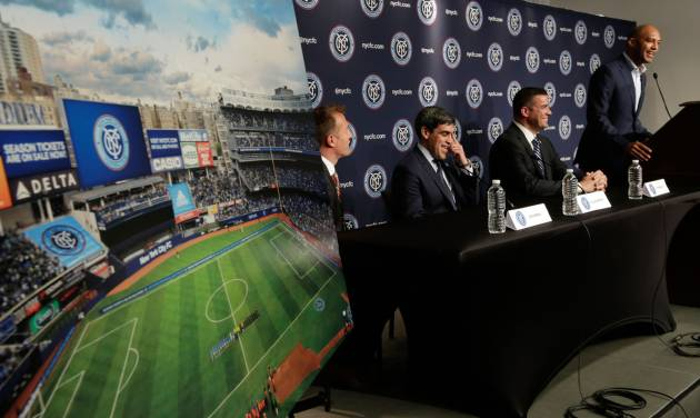Retired New York Yankees pitcher Mariano Rivera, right, addresses a New York City Football Club news conference at New York's Yankee Stadium,  Monday, April 21, 2014. Seated, from left, are head coach Jason Kreis, Director of Football Operations Claudio Reyna, and Chief Business Officer Tim Pernetti. The Yankees announced that Yankee Stadium will serve as the Club's first home and begin play on March 2015. (AP Photo/Richard Drew)