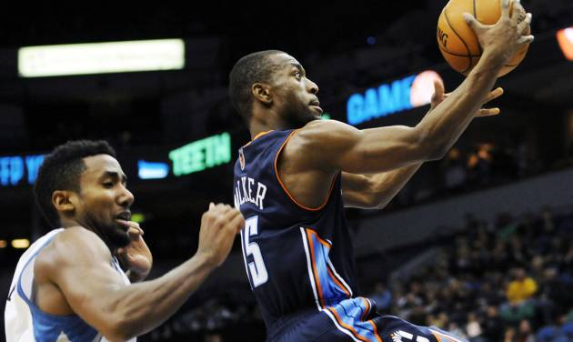 Charlotte Bobcats' Kemba Walker, right, drives to the basket ahead of Minnesota Timberwolves' Malcolm Lee in the second half of an NBA basketball game, Wednesday, Nov. 14, 2012, in Minneapolis. The Bobcats won 89-87. Walker led the Bobcats with 22 points. (AP Photo/Jim Mone)
