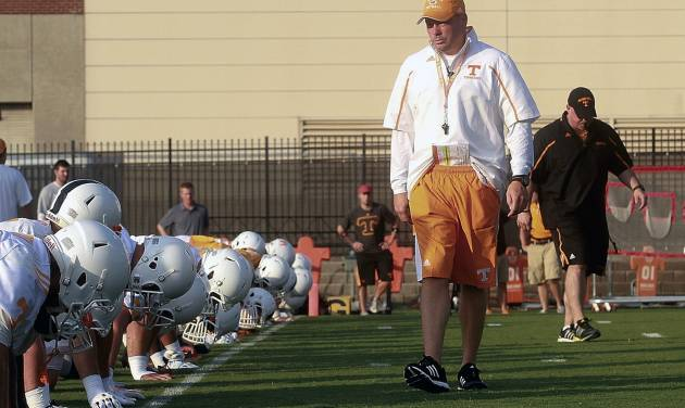 University of Tennessee head coach Butch Jones looks over his team during practice Friday, Aug. 1, 2014, in Knoxville, Tenn. (AP Photo/The Daily Times, Mark A. Large) MANDATORY CREDIT