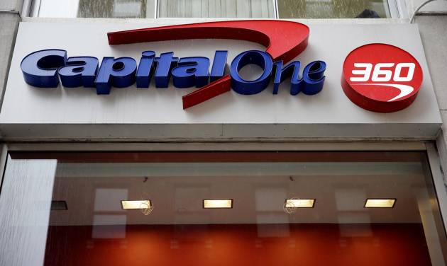 FILE - In this Jan. 14, 2014, file photo, a Capital One sign is displayed in Philadelphia. Capital One Financial Corp. reports quarterly financial results after the market close on Wednesday, April 16, 2014. (AP Photo/Matt Rourke, File)
