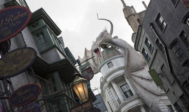 """This June 2014 photo released by Universal Orlando Resort shows """"The Wizarding World of Harry Potter – Diagon Alley,"""" from the Harry Potter-themed area of Universal Orlando Resort in Orlando, Fla. The attraction, featuring shops, dining experiences and the next generation thrill ride, will officially open on July 8. (AP Photo/Universal Orlando Resort, Sheri Lowen)"""