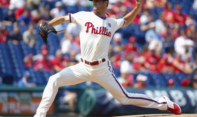 Philadelphia Phillies starting pitcher Cole Hamels pitches during the first inning of a baseball game against the Seattle Mariners, Wednesday, Aug. 20, 2014, in Philadelphia. (AP Photo/Chris Szagola)