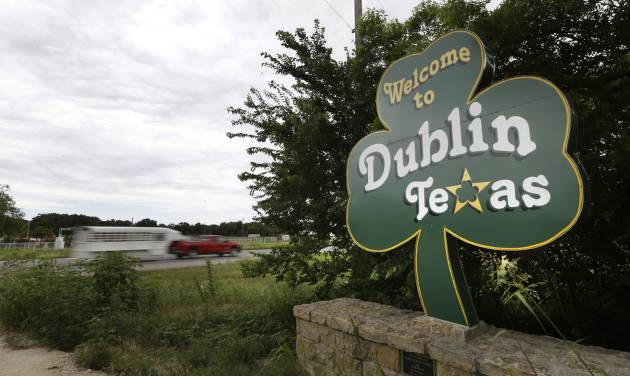 In this June 14, 2014 photo, a shamrock sign welcomes drivers to Dublin, Texas.  Most of Dublin's 3,887 residents believe the connection to Ireland is mythical, and that their town is more likely named after the settler expression for seeking protection from Plains attackers by circling their wagons at night, or doublin' up. (AP Photo/LM Otero)