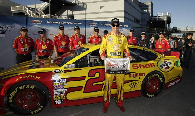 Joey Logano poses for photos after winning the pole position for Sunday's NASCAR Sprint Cup Series auto race, Friday, March 7, 2014, in Las Vegas. (AP Photo/Isaac Brekken)