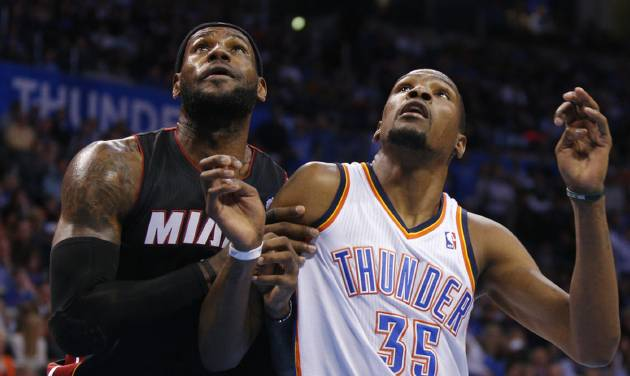 The Thunder's Kevin Durant, right, is drawing the assignment of stopping opponents' top players, like Miami's LeBron James, left.                    Photo by Bryan Terry, The Oklahoman