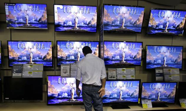 A shopper looks at televisions at a Best Buy store, Friday, Nov. 23, 2012, in Franklin, Tenn., after the store opened at midnight. Black Friday, the day when retailers traditionally turn a profit for the year, got a jump start this year as many stores opened just as families were finishing up Thanksgiving dinner. (AP Photo/Mark Humphrey)