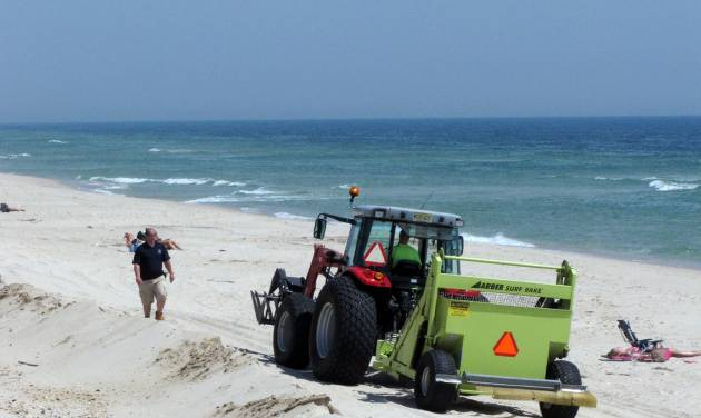 In this May 12, 2014 photo, a beach sweeper cleans the sand in the Ortley Beach section of Toms River N.J. Experts say most of the Jersey shore's beaches came through the winter in fine shape, and are in their best condition in years as the second summer after Superstorm Sandy approaches. (AP Photo/Wayne Parry)