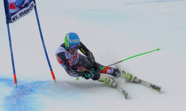 Usa's Ted Ligety of the United States speed down the course during the first run of an alpine ski men's World Cup giant slalom in St. Moritz, , Switzerland, Sunday, Feb. 2, 2014. (AP Photo/Pier Marco Tacca)