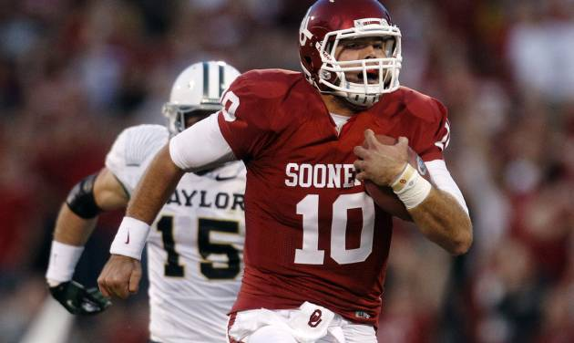 Oklahoma quarterback Blake Bell (10) takes off on a 55-yard keeper in the fourth quarter for a touchdown against Baylor and the longest run by a quarterback in the Stoops era during an NCAA college football game in Norman, Okla., Saturday, Nov. 10, 2012. Oklahoma won 42-34. Baylor linebacker Brody Trahan (15) pursues. (AP Photo/Sue Ogrocki)