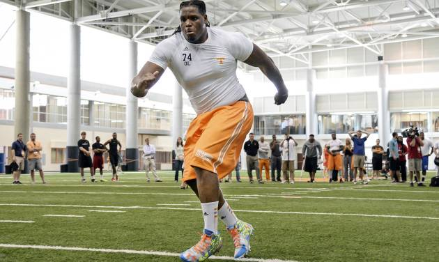 "In this photo provide by the University of Tennessee Athletics Department, Tennessee offensive tackle Antonio ""Tiny"" Richardson takes part in the school's NCAA college football pro day Wednesday, April 2, 2014, in Knoxville, Tenn. (AP Photo/Tennessee Athletics, Donald Page)"