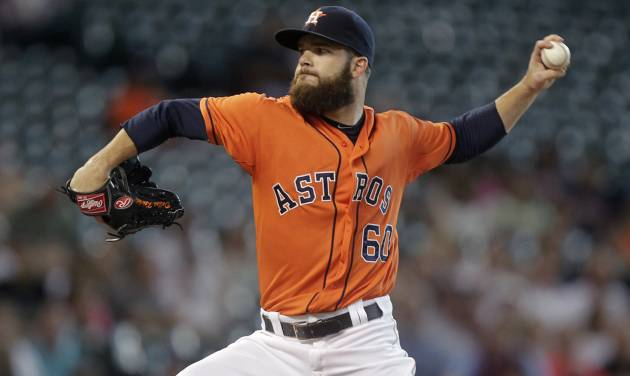 Houston Astros pitcher Dallas Keuchel throws during the first inning of a baseball game against the Miami Marlins, Friday, July 25, 2014, in Houston. (AP Photo/Patric Schneider)