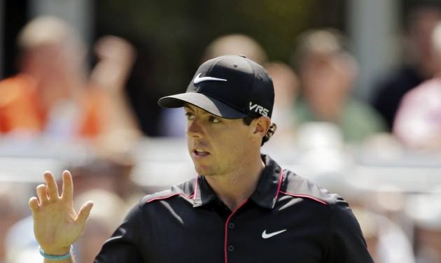 Rory McIlroy, from Northern Ireland, waves to the crowd after a birdie on the 13th hole during the first round of the Bridgestone Invitational golf tournament Thursday, July 31, 2014, at Firestone Country Club in Akron, Ohio. (AP Photo/Mark Duncan)